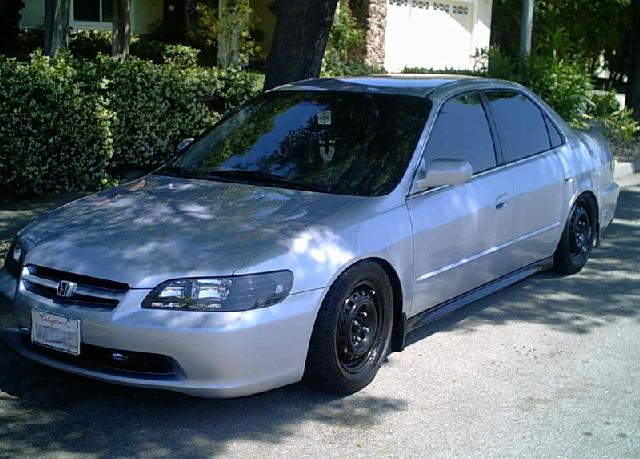 Does anyone have pics of completely black housed headlights on their rides?-blackslammedmed.jpg